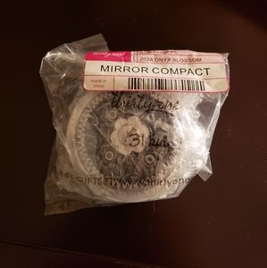 Thirty one compact mirror